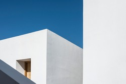 Generic geometric minimalist white architecture on a clear sunny day.