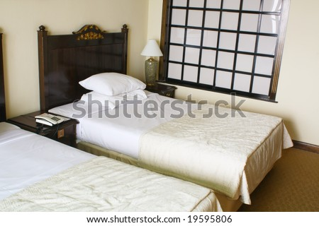 Generic Hotel Bed Room With Sunlight Coming In