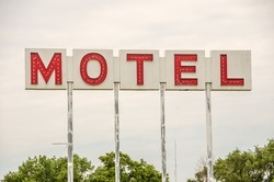 Generic motel sign in the USA with red letters on a white background