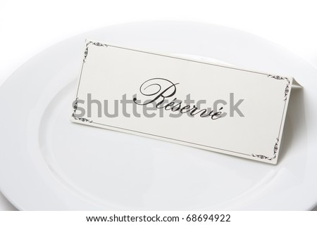 Generic reserved sign card on a white plate