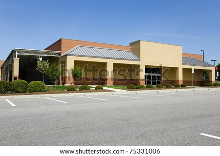 Generic retail  hardware store building with parking lot