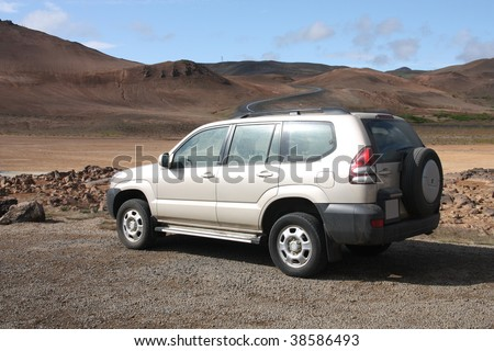 Generic SUV or all terrain car in Icelandic badlands. Hverir volcanic area.
