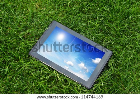 generic tablet computer (tablet pc)  on green grass