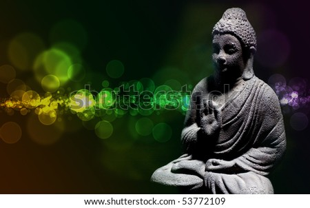 Generic zen stone buddha statue with light shinning on the figure