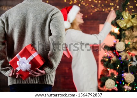 Generosity and kindness. Prepare surprise. Winter surprise. Man carry gift box behind back defocused background. Christmas surprise concept. Surprising his wife. Giving and sharing. Surprise effect.