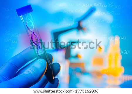 Genetic tests. Laboratory test tube with a picture of DNA. Abbreviations of hereditary diseases. The study of human genetic characteristics. Chromosomal analysis. Stok fotoğraf ©
