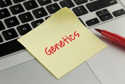 Genetics sticky note pasted on the keyboard