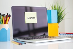 Genetics sticky note pasted on the laptop