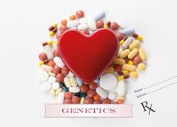 GENETICS written on heart and medication background