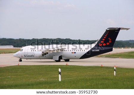 GENEVA - AUGUST 16: Avro 146 RJ100 of Brussels Airlines at Geneva Airport on August 16, 2008. European Comission recently granted approval for Lufthansa to take over Brussels Airlines. - stock photo