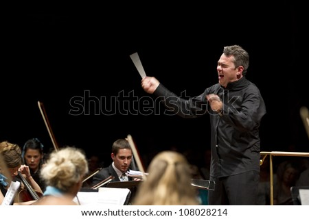 GENEVA - JUNE 24: Conductor Antoine Marguier conducts the United Nations Orchestra at the Victoria Hall June 24, 2012 in Geneva, Switzerland.