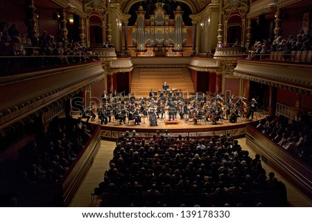 GENEVA � MARCH 20: Soloist violinist Solenne Paidassi playing with the United Nations Orchestra conducted by Antoine Marguier at the Victoria Hall March 20, 2013 in Geneva, Switzerland.