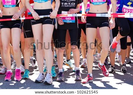 GENEVA - MAY 5: Unidentified athletes at the start of the women's race of the 2012 Geneva Marathon for UNICEF, May 5, 2012 in Geneva, Switzerland.
