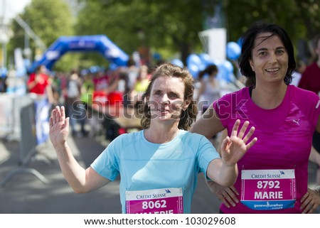GENEVA - MAY 5: Unidentified athletes celebrate after finishing the women's race of the 2012 Geneva Marathon for UNICEF, May 5, 2012 in Geneva, Switzerland.