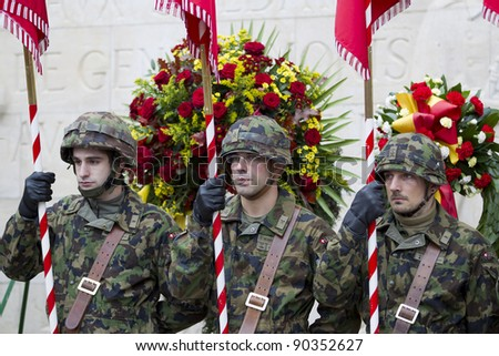 GENEVA - NOVEMBER 13: Soldiers stand to attention at the memorial service to Geneva soldiers on November 13, 2011 in Geneva Switzerland, attended by veterans and serving soldiers