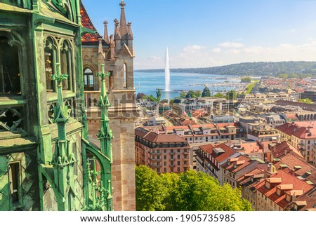Geneva skyline, Leman Lake, Jet d'eau fountain, bay, harbor and Tower of Cathedral, French Swiss in Switzerland. View of Romanesque bell tower and spire of Saint-Pierre Cathedral. Sunny day blue sky. Foto d'archivio ©