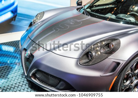 Geneva, Switzerland, March 06, 2018: metallic silver Alfa Romeo 4C (Type 960) at 88th Geneva International Motor Show GIMS, mid-engined, lightweight, rear-wheel drive sports car #1046909755