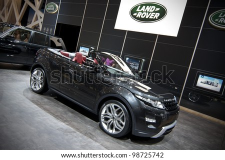 GENEVA SWITZERLAND - MARCH 12: The Land Rover Stand featuring the Range Rover Evoque convertible concept being shown at the Geneva Motorshow on March 12th, 2012 in Geneva, Switzerland.
