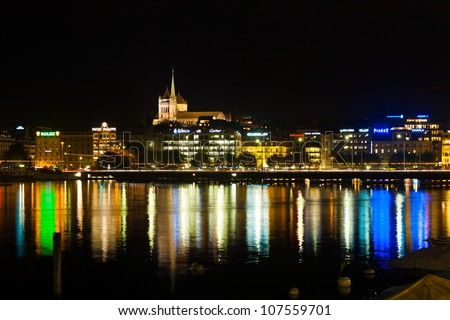 GENEVA, SWITZERLAND - SEPTEMBER 29, 2010: Waterfront luxury brand offices and old town cathedral in Geneva, Switzerland on September 29, 2010. Geneva is a hub of finance and luxury brands.