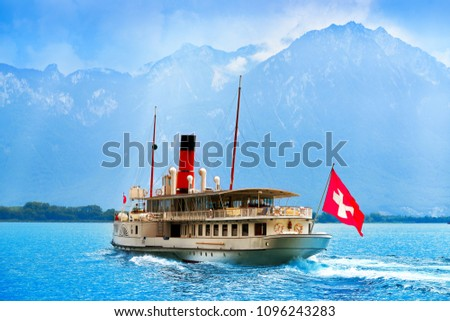 Geneve Lake Leman Geneva paddle steamer ship Switzerland with Swiss flag