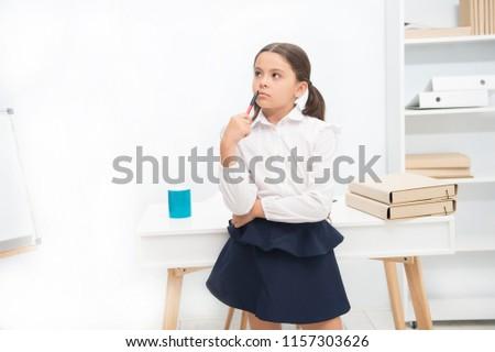 Genius concept. Genius girl lost in thoughts. Genius child solve problem. Genius pupil back to school. Use your brain.