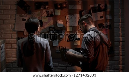 Genius detectives analyzing press clipping and photo information about crime