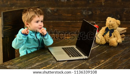 Genius kid. Genius child with laptop. Genius boy with computer. Genius technology for future. Point in the right direction.