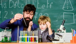 Genius kid. Teacher child test tubes. Chemical experiment. Achieving developmental milestones way before predicted sign that child ready to be challenged. Genius minds. Genius toddler private lesson.