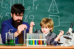 Genius minds. Genius toddler private lesson. Genius kid. Teacher child test tubes. Achieving developmental milestones way before predicted sign that child ready to be challenged. Chemical experiment.