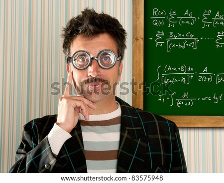 Genius nerd glasses silly man board math formula pensive gesture thinking expression [Photo Illustration]