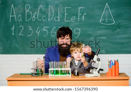 Genius toddler private lesson. Genius kid. Joys and challenges raising gifted child. Teacher child test tubes. Chemical experiment. Genius minds. Signs your child could be gifted. Special and unique.