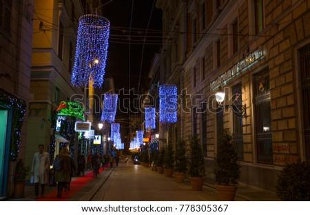 GENOA (GENOVA), ITALY, DECEMBER 14, 2017 - Christmas illuminations on the streets of center of Genoa by night, Italy. #778305367