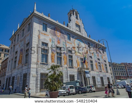 GENOA, ITALY - JUNE 2, 2015: Unidentified people by Palazzo San Giorgio in Genoa, Italy. Palace was built in 1260 and facade was refrescoed in the late 19th century #548210404