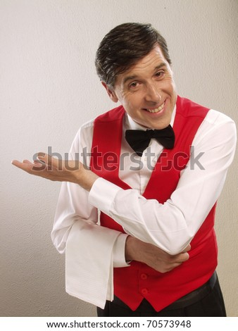 Gentile waiter portrait on white background.