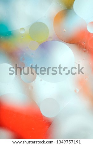Gentle abstract blurred background. The texture of the liquid with circles and bubbles of yellow, red and green and white in different sizes. Cropped shot, macro, vertical, nobody, free space for text #1349757191