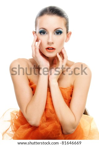 Gentle charming young woman in orange shawl, on white background.