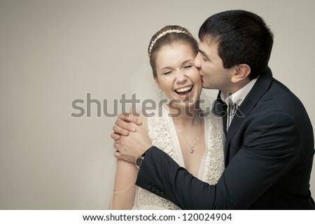 gentle couple of lovers groom and bride. studio shooting at white background