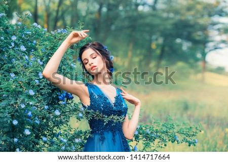 gentle image of a nymph in a long elegant elegant dress, a girl like an amazing cornflower flower. field mermaid dreams with her eyes closed, young princess dancing next to a fabulous forest #1414717664