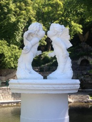 Gentle kissing angels in the garden. Ideal for greeting cards for the St. Valentine's Day (February 14)