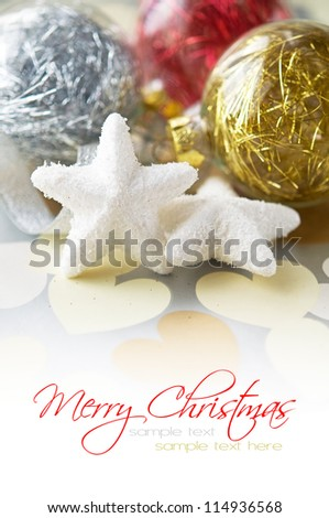 Gentle xmas baubles on holiday background