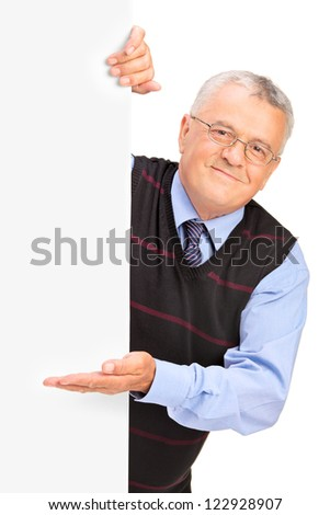 Gentleman posing behind a blank panel and gesturing isolated on white background