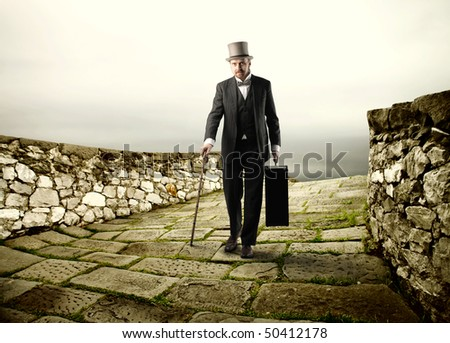 Gentleman standing on an old stone bridge