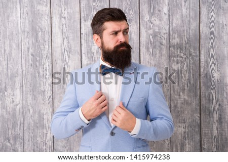Gentleman style barber. Barber shop offer range of packages for groom make his big day unforgettable. Barber shop concept. Beard and mustache. Guy well groomed handsome bearded hipster wear tuxedo.