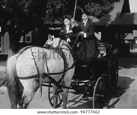 Gentlemen driving carriage with horse hitched backwards