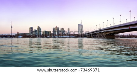 Gently colored Skyline of Danube City Vienna next to the Reichsbrücke (german for Empire Bridge). - stock photo