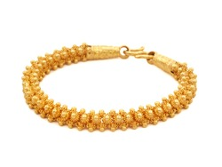 Genuine gold bracelet ancient design  isolated on white background.