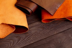 Genuine leather in rolls background. The fabric is artificial eco-leather. Upholstery material for furniture upholstery.
