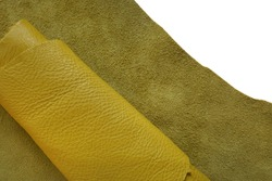Genuine leather  isolated on white background.Yellow genuine leather roll.real leather surface. Hobby and craft material. leather texture close-up.Material for shoes and accessories.Manufacture
