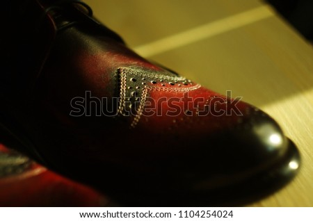 Genuine leather Italian  man shoes. Oxfords. Dark brown and red vinous color. Classic Vintage style. Close-up #1104254024