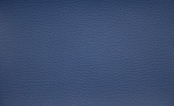 Genuine leather painted blue. Background. Texture. Close-up.